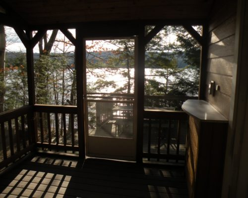 photo from the sun porch of cabin with view of the lake